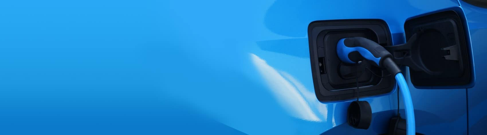 Close up electric vehicle charging blue banner