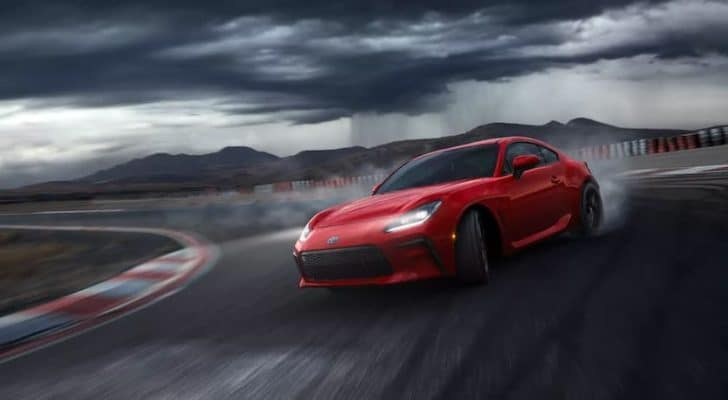 A red 2022 Toyota GR 86 is angled left.
