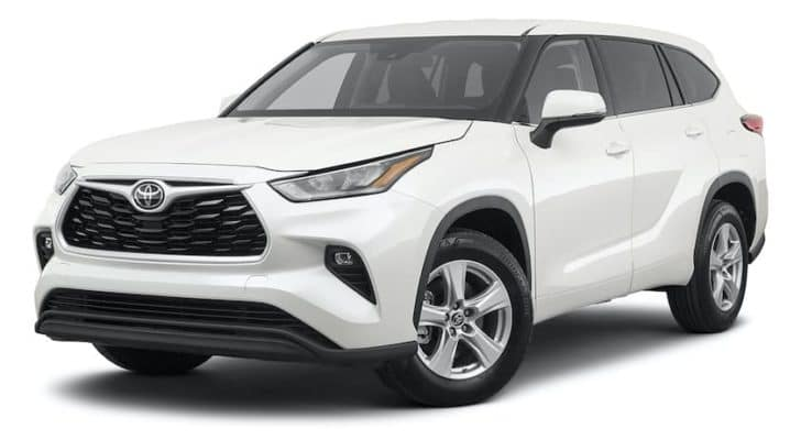 A white 2021 Toyota Highlander LE is angled left.
