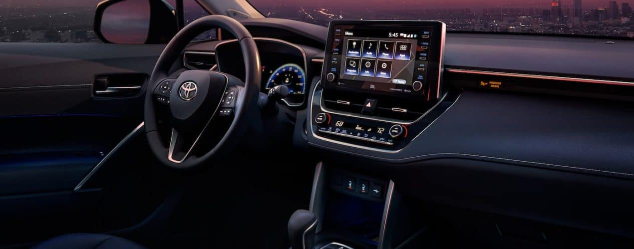 The black interior and dash is shown in a 2022 Toyota Corolla Cross XLE.
