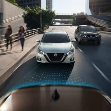2019-Nissan-Altima-models-shown-approaching-from-rear-on-street