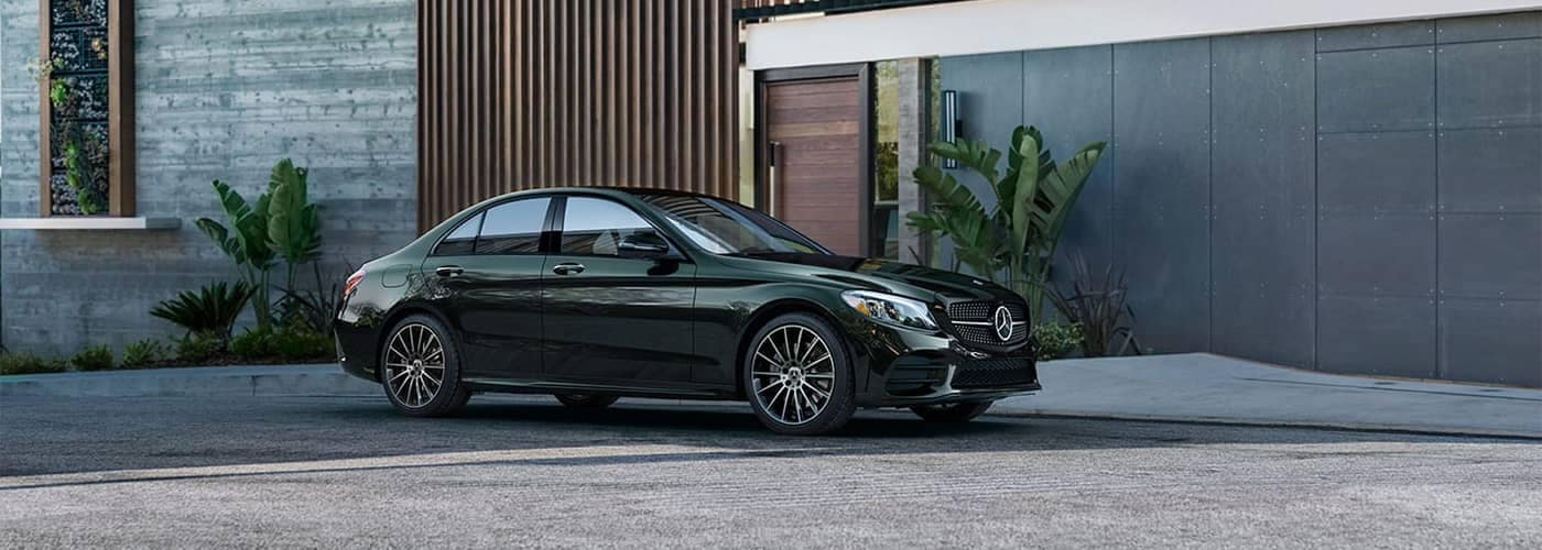 Mercedes-Benz C-Class Parked in Front of Home