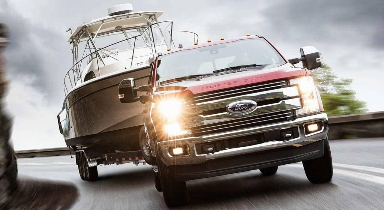 2019 Ford Super Duty Lariat tows a boat